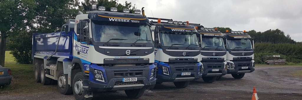Wessex Demolition lorry fleet parked up at the aggregates yard in Southampton, Hampshire