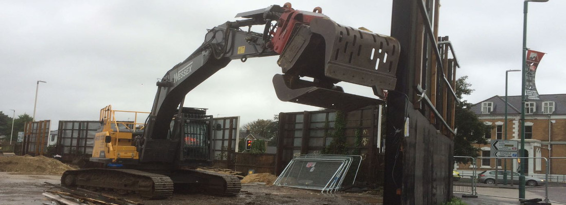 Demolition works by Volvo EC250EL