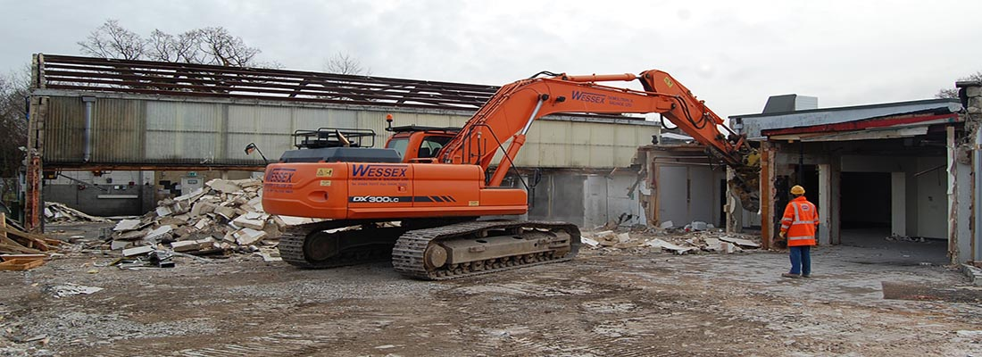 Doosan DX300 excavator in dismantling process at site in Hythe, Hampshire