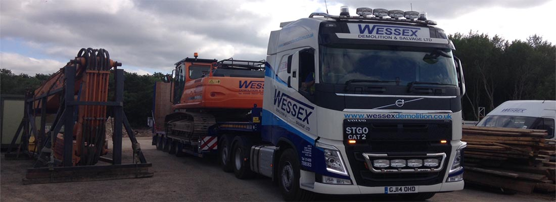 Volvo FH540 Low Loader moving an excavator from the yard in Southampton, Hampshire