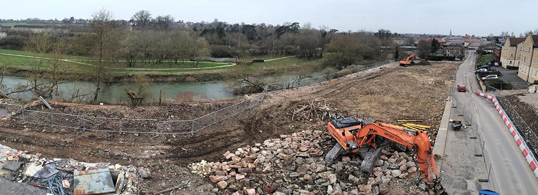 Doosan DX340 Excavator in process of site clearance works in Chippenham, Wiltshire
